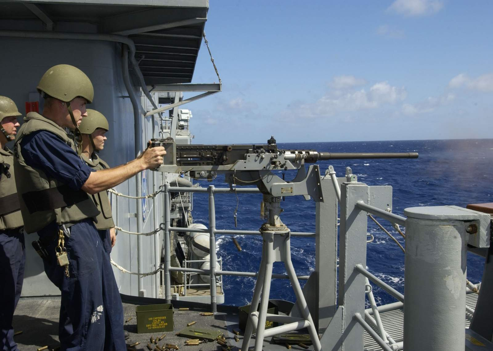 ,_fires_a_few_rounds_from_the_ship%27s_.50_cal_weapons_mount_during_a_small_arms_firing_exercise.