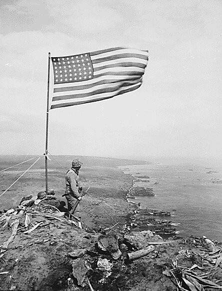 Stars_and_Stripes_on_Mount_Suribachi_(Iwo_Jima).