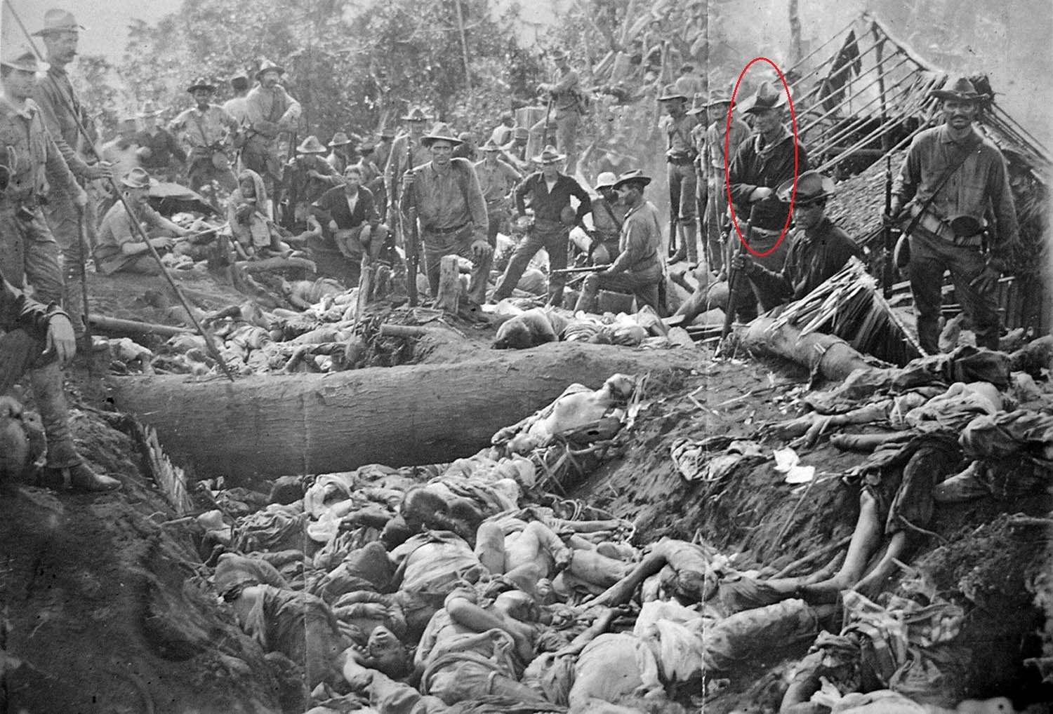 US soldiers pose with the bodies of Moro insurgents, Philippines, 1906 Roy Rainey Hart.